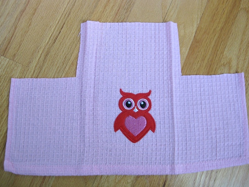 pink fabric with red owl cut into bag shape