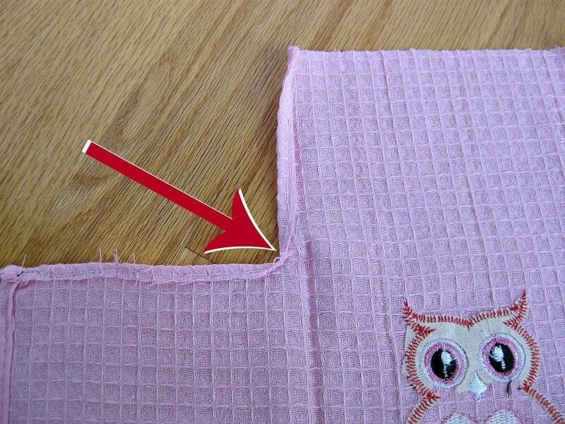 arrow pointing to seam of pink bag