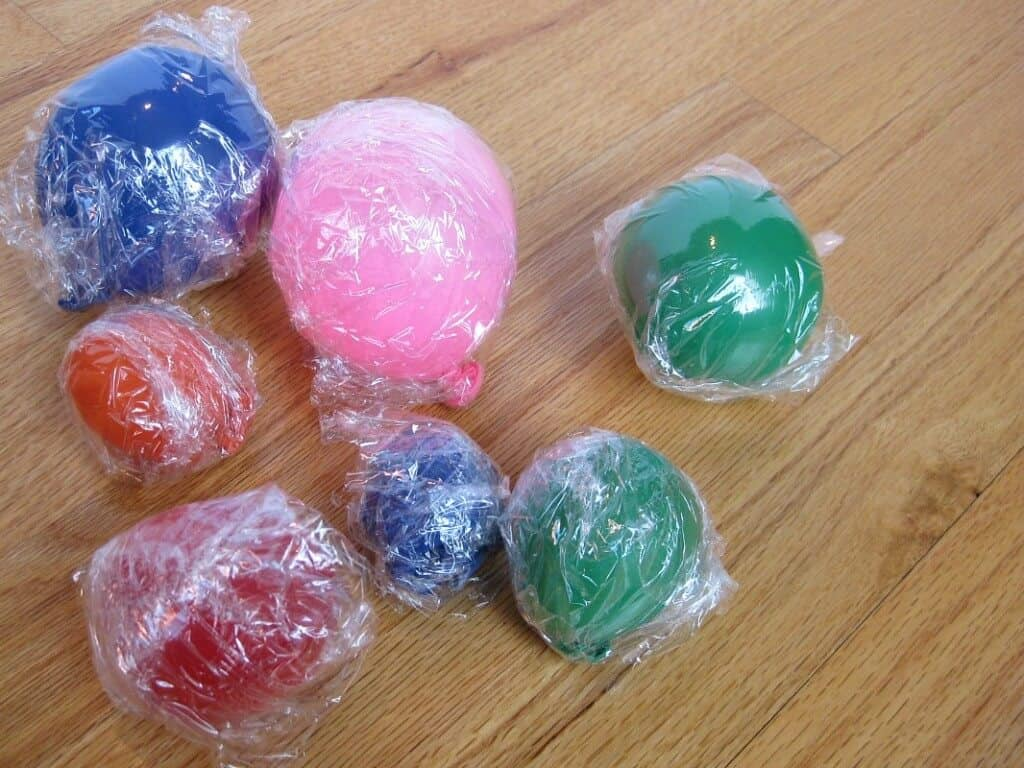 inflated balloons wrapped in plastic wrap