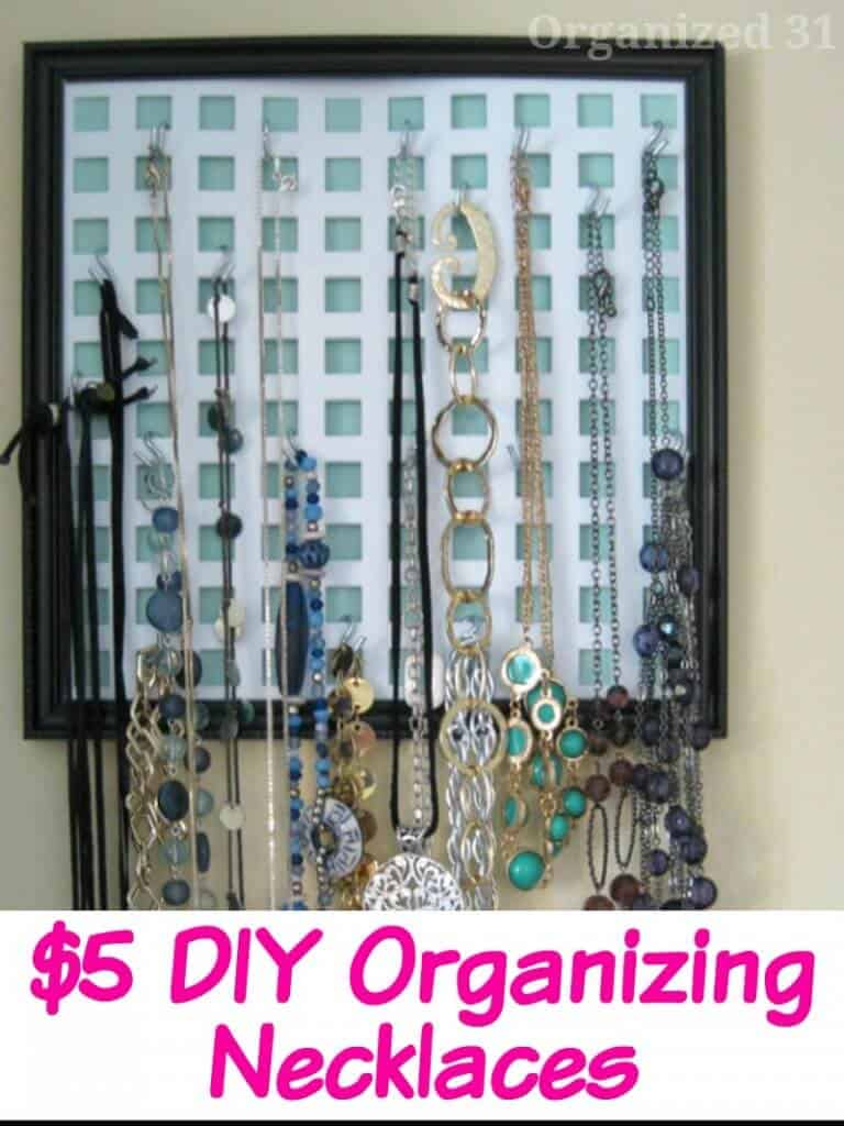 necklaces hanging on DIY wall jewelry hanger