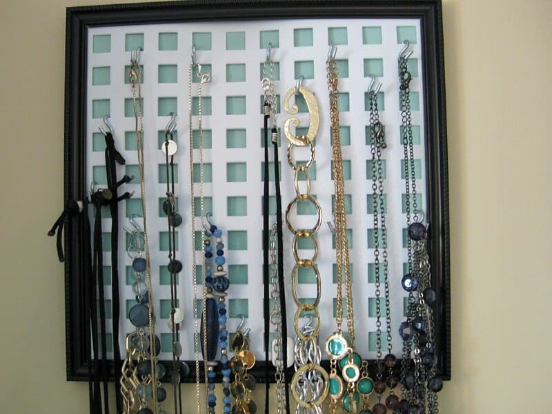 necklaces hanging on wall organizer