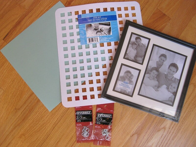 tutorial supplies, black picture frame, white drain mat, 2 packages of metal S hooks, blue craft paper on wood table