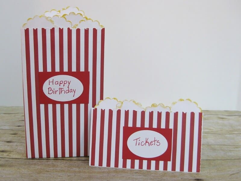2 paper crafted red and white striped popcorn boxes