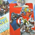 red clipboard with Avenger characters