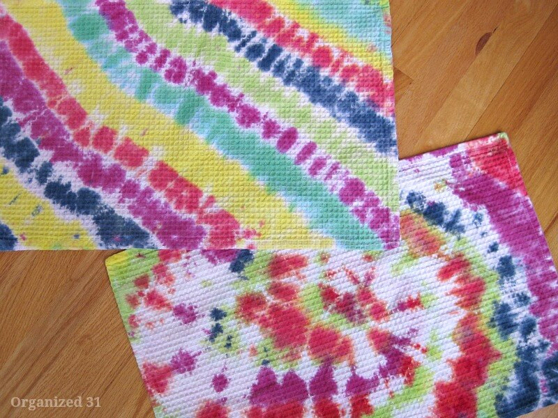 2 colorful tie dyed towels on wood table