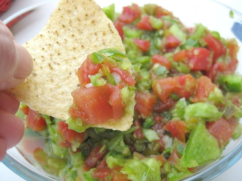 This Easy-to-Make Salsa Recipe gets rave reviews every time and is so very easy to make. It's perfect for the Big Game or for Cinco De Mayo entertaining.