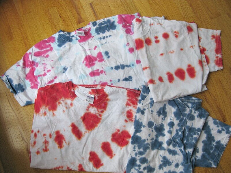 stack of t-shirts tie-dyed in red, white and blue