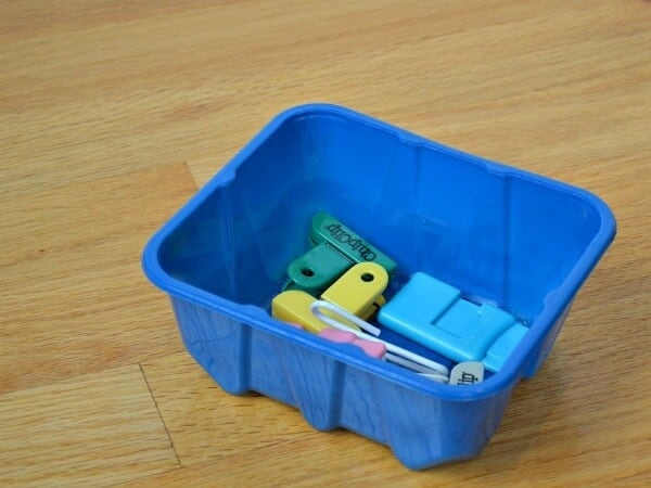 blue container holding chip clips