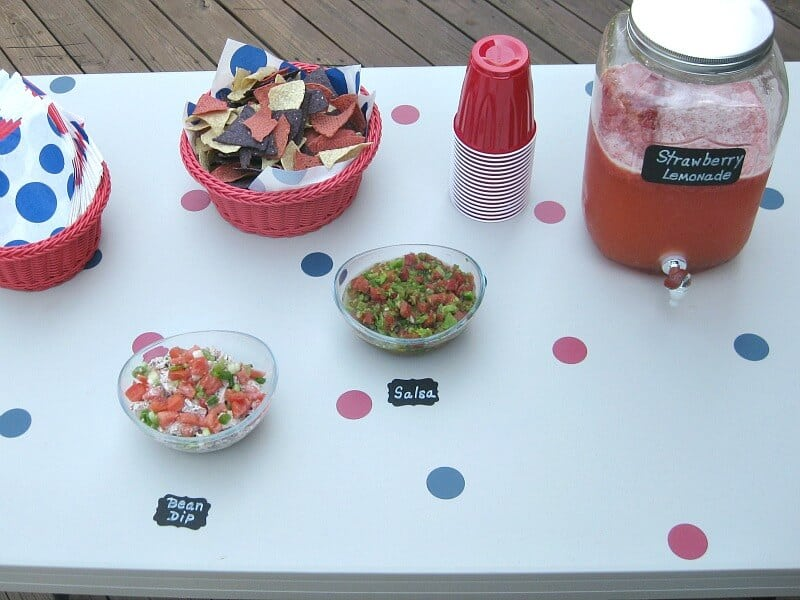 overhead view of party table with polka dots and black labels