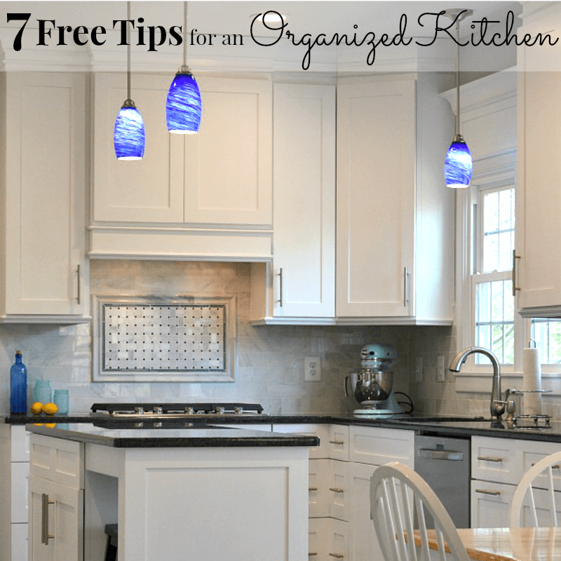 neat and organized white and black kitchen with blue lights
