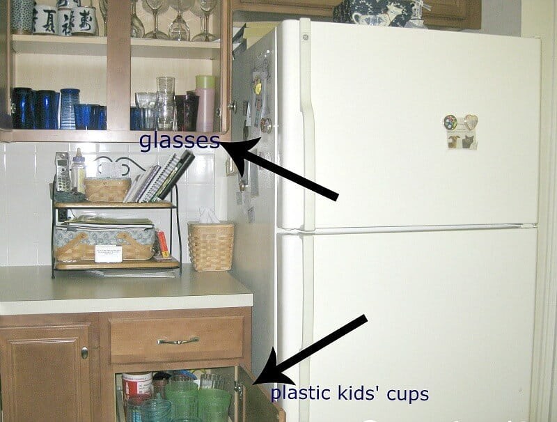 open cabinets next to refrigerator showing contents