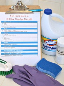 checklist and cleaning supplies by shower
