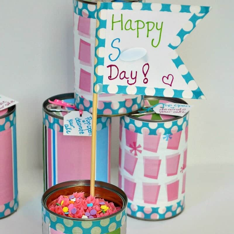 3 cans of birthday cake and birthday cake banner