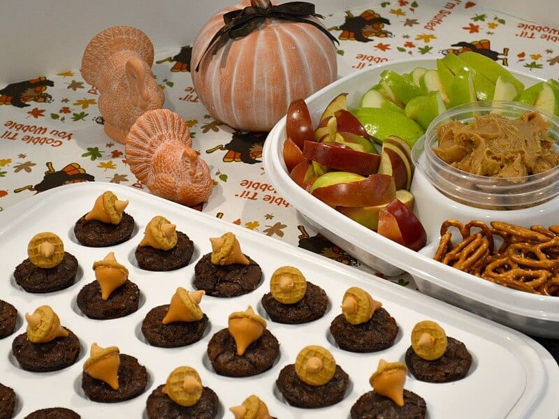 tray of autumn brownies with tray of fruit and Thanksgiving decorations