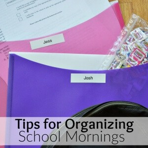 colorful folders on table with papers and bag of box tops