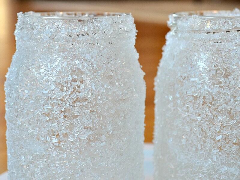 close up of 2 white crystallized jars