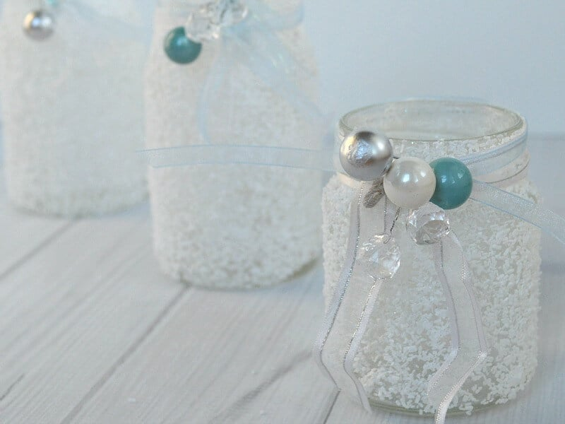 Make these easy DIY Wintry Epsom Salt jars for pennies and in minutes using recycled glass jars.