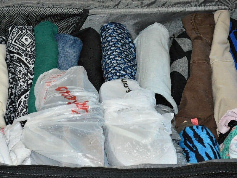 Simple Holiday Air Travel Tips #LetsTalkCents [ad] Packing Clothes with outfits together.