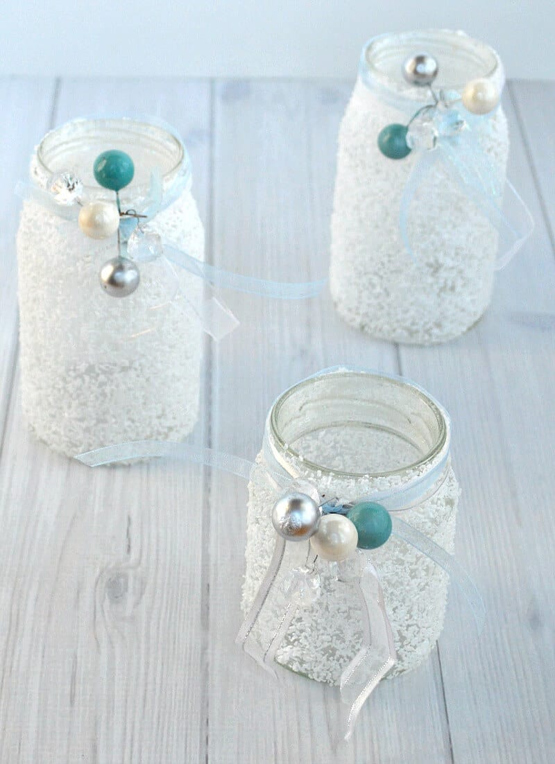 3 white frosty jars with ribbons and white, blue and silver beads