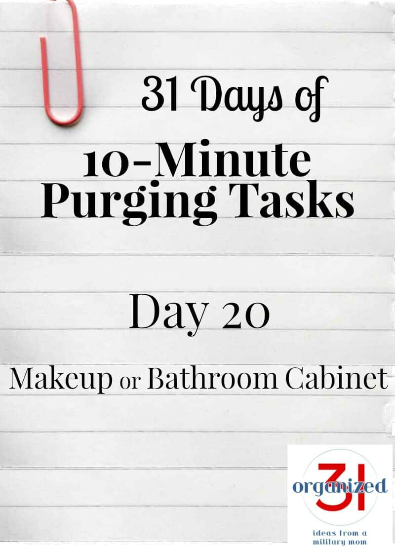 "Notebook paper with pink paperclip and ""Day 20 Makeup or bathroom cabinet"""
