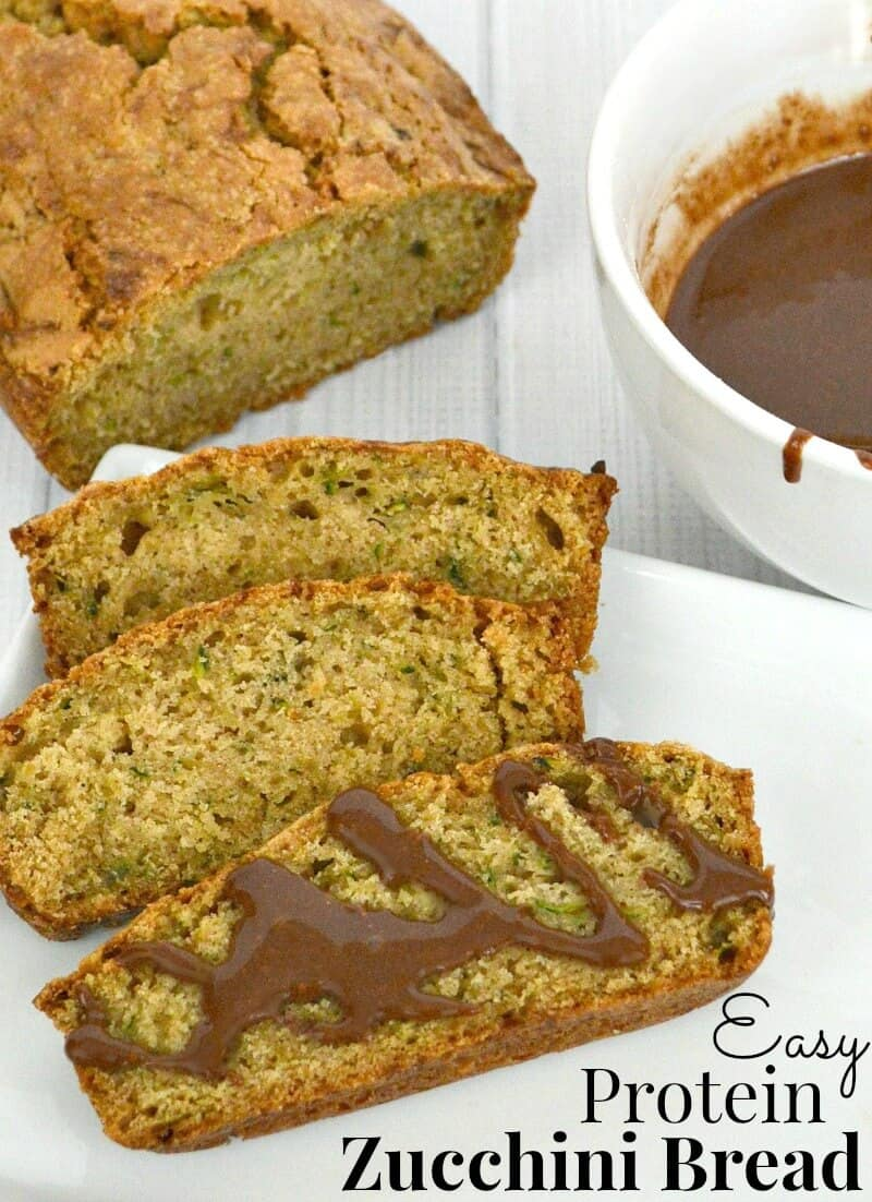 3 slices of zucchini bread next to loaf and bowl of chocoate