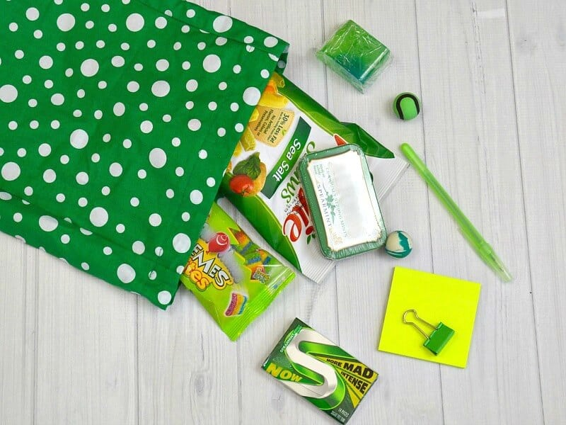 overhead view of green items spilling out of green polka dot bag