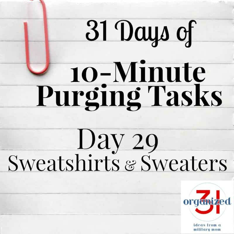 notebook paper with large pink paperclip and text reading 31 Days of 10-Minute Purging Tasks Day 29 Sweatshirts & Sweaters