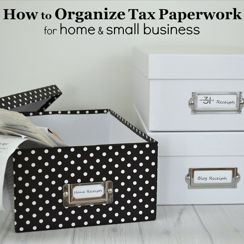 black and white polka dot box with papers next to stack of white boxes with labels