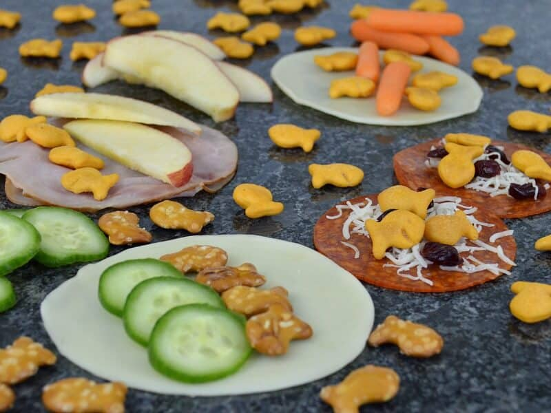 close up of snacks with fish crackers scattered on counter