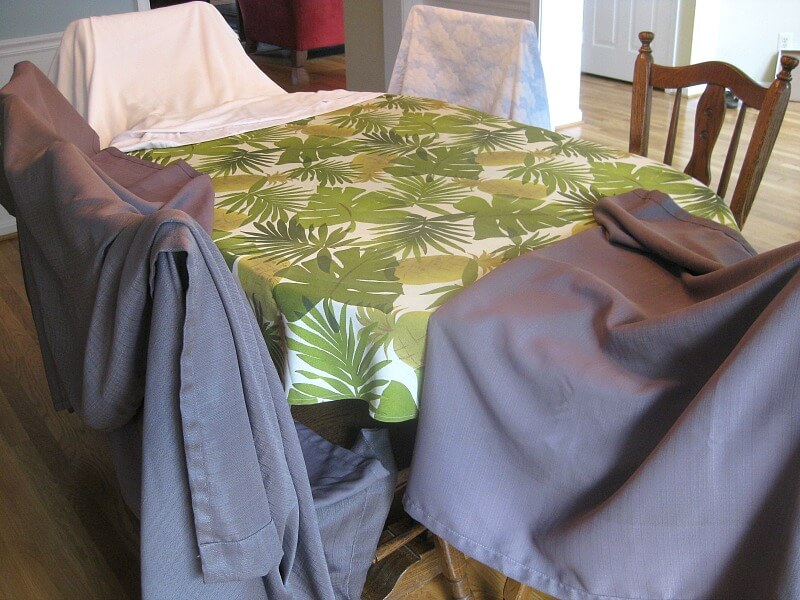 curtains draped over dining room chairs