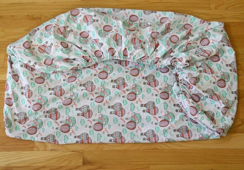 overhead view of neatly folded fitted sheet
