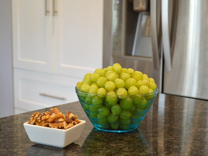 bowl of grapes and bowl of nuts on kitchen counter