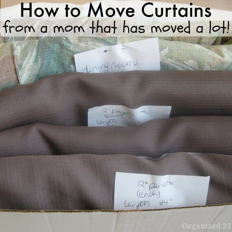 close up of brown and green curtains folded with label in box