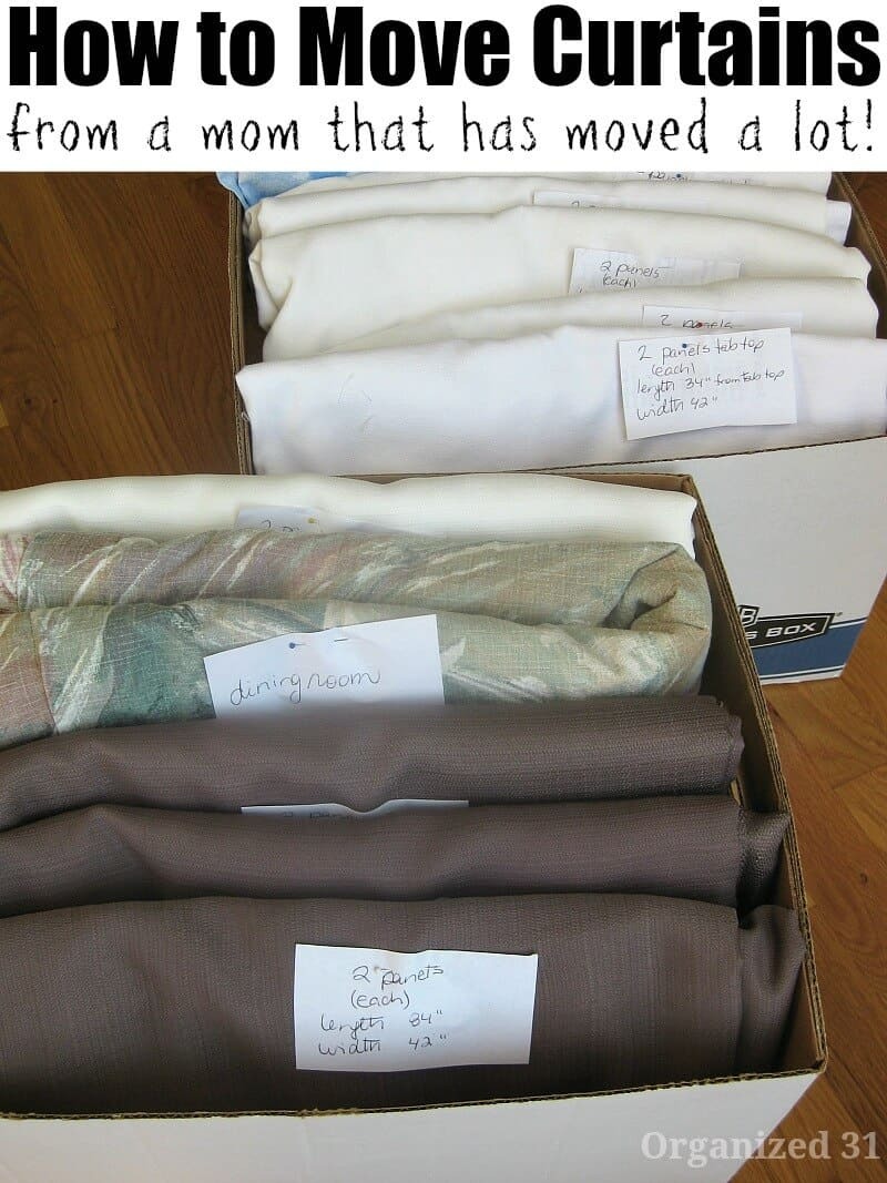 curtains folded and labels in moving box