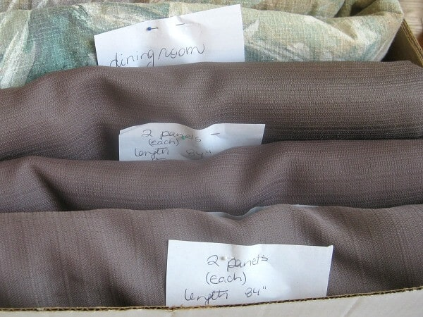 Folded curtains with descriptive tags in box