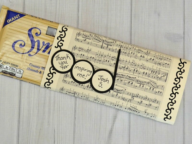 paper sleeve for candy bar made from sheet music with personalized message