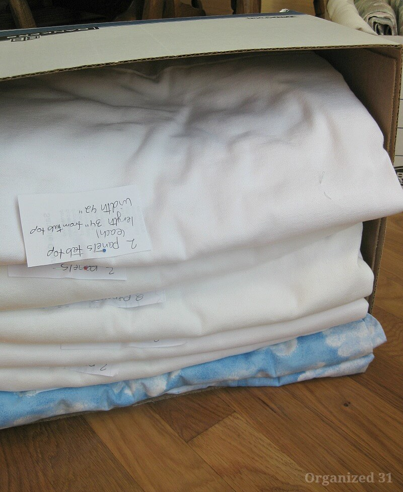 folded curtains in box and tilted on side