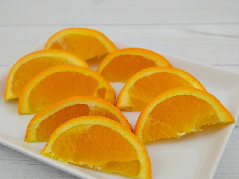 orange slices on white plate