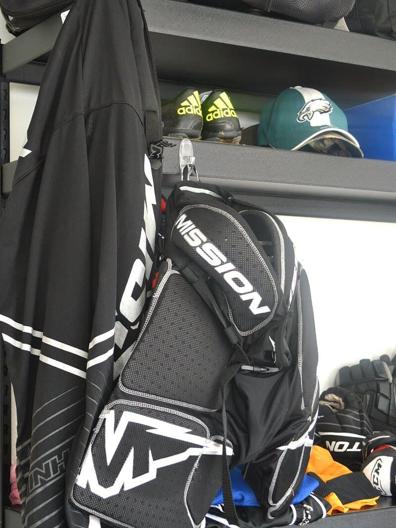 close up of hockey equipment on black shelf