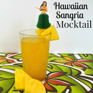 Make this easy Mocktail Hawaiian Sangria Recipe with pineapple and mango. It's perfect for relaxing on a hot summer day with friends. #NewWaytoSparkle [ad]