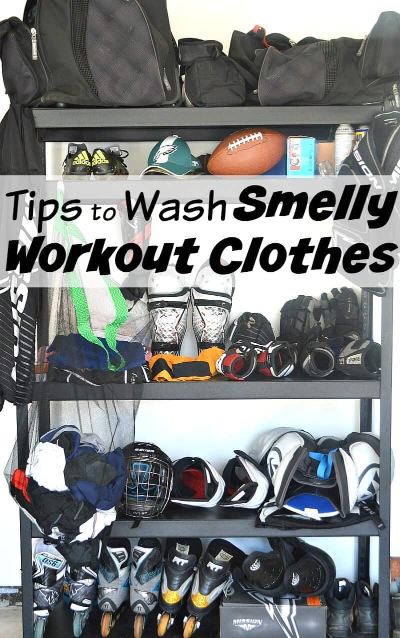 black shelving unit with hockey equipment on every shelf and mesh laundry bag hanging on it