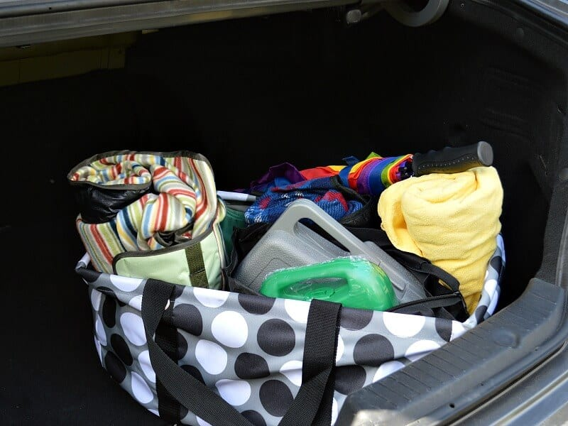 large bag in car trunk with blankets and tool box