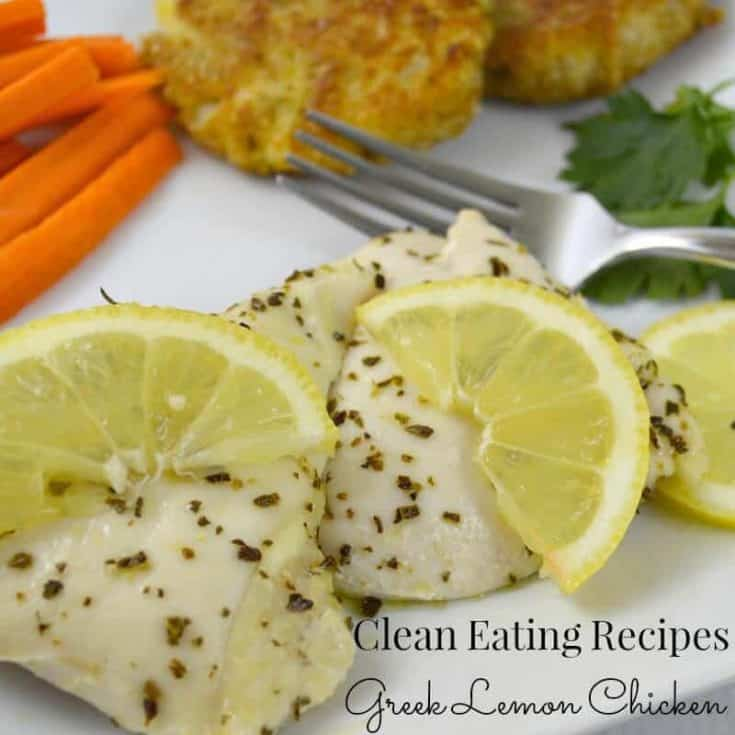 chicken breast with spices and lemon slices and carrots and potato pancakes in background