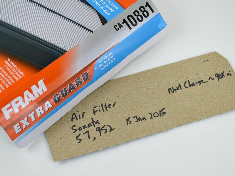 car air filter box with details written on flap