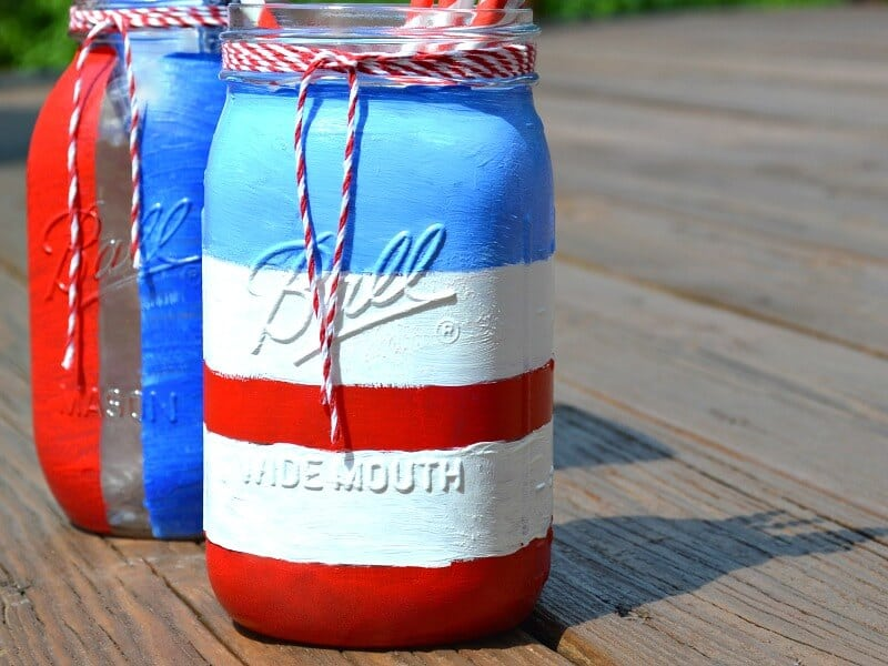Patriotic Mason Jar Craft Ideas are easy to make with a little craft paint and about 20 minutes of time. It's a great kids' craft and recycling craft DIY project perfect for the 4th of July or any patriotic occasion.