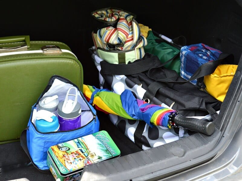 car trunk packed with suitcases and bags