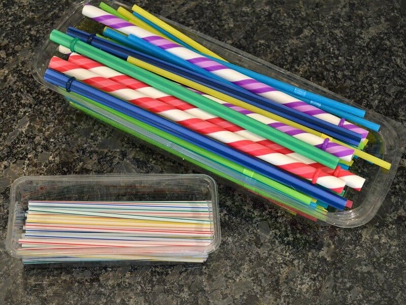 2 clear containers holding straws