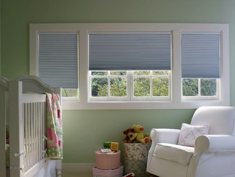 sunny and cheerful children's room with blinds on window
