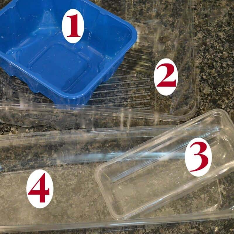 three clear containers and one blue container with numbers identifying them