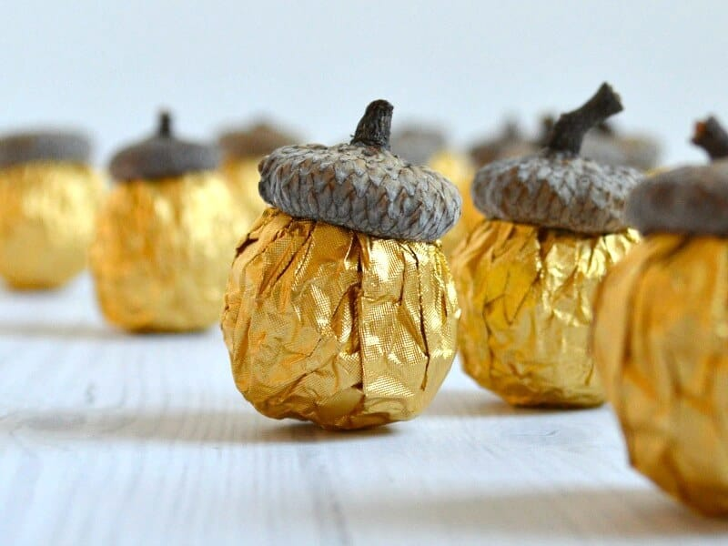 close up of many gold foil DIY candy acorns